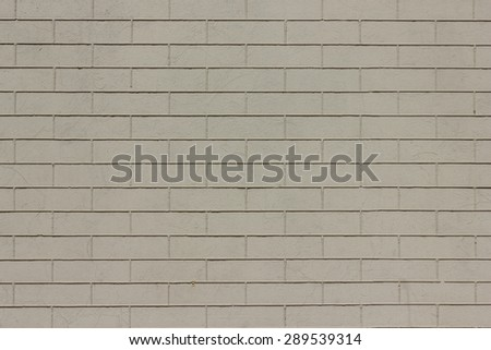 the texture of the brick wall of light gray color - stock photo
