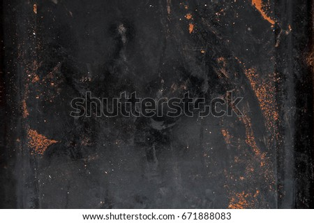 The texture of the old metal plate with scattered cocoa powder