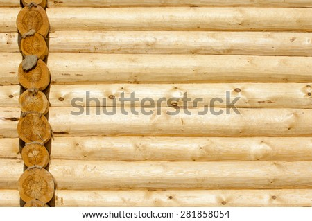 The texture of the wooden house. Logs the texture of the wooden house. Shield with a large number of parallel wooden logs texture - stock photo