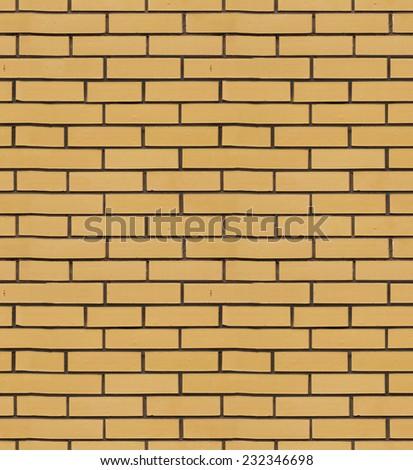 The texture of yellow brick cladding tiles - stock photo