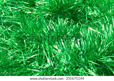 The texture on the entire frame of the Christmas tinsel green - stock photo