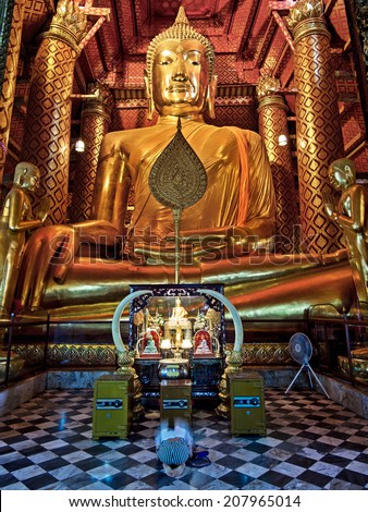 The 14th century Buddha statue at Wat Phanan Choeng temple in Ayutthaya, the former capital of Thailand. - stock photo
