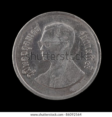 The Thai coin on the black background