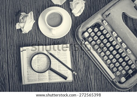 The thai dictionary consider under a magnifier on writer's desk with crumpled sheets around                                                - stock photo