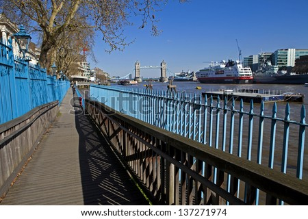 The Thames Path leading to Tower Bridge in the distance. - stock photo