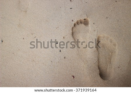 the therapy foot prints on the beach. - stock photo