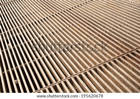 The thick rusty metal grate with a rough texture - stock photo