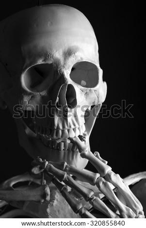 The Thinking Skeleton on black background - stock photo