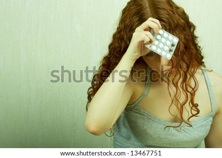 The thoughtful girl holds in a hand of a tablet and reflects on the developed situation - stock photo