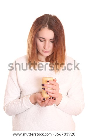 The thoughtful girl with a candle isolated white background - stock photo
