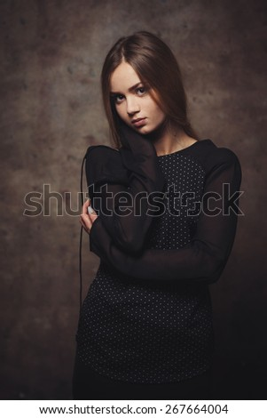 The thoughtful woman attentively looks. - stock photo