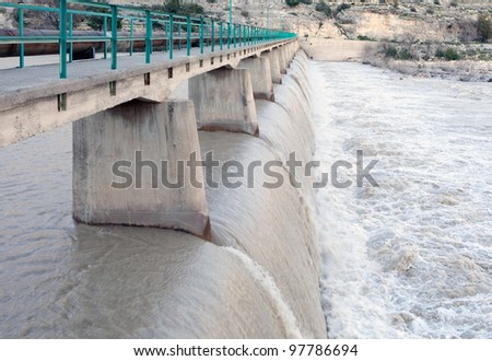 The threat posed by too much water from Dam - stock photo