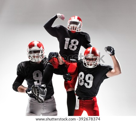 The three american football players posing on white background - stock photo
