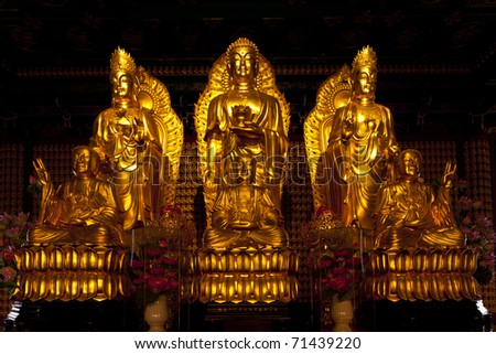 The three Chinese Buddha in the temple of Thailand - stock photo