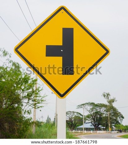The three intersection traffic sign - stock photo