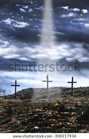 The three old wooden crosses on the hill. - stock photo
