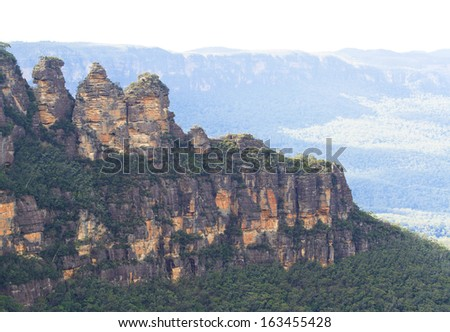 The Three Sisters a rock formation in the Blue Mountains of New South Wales, Australia. A famous land mark and tourist destination near to Sydney, Australia. - stock photo