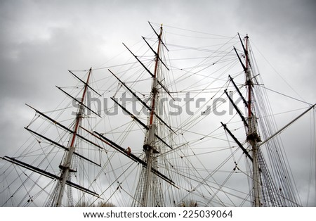The three wooden masts and rigging of Sailing Boat or Clipper - stock photo