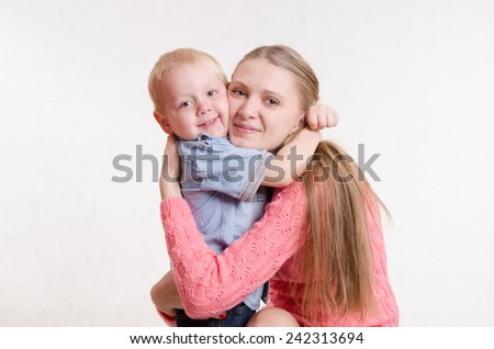 The three-year child hugging her mother