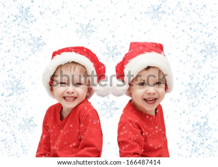 the three-year-old  twins childs in Santa Claus - stock photo