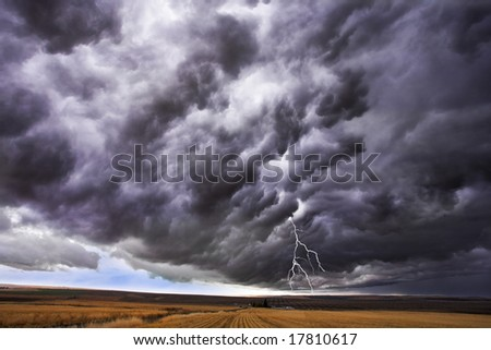 The thundercloud and lightning above boundless plain in state of  Idaho. - stock photo