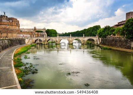 The Tiber River, winding Rome and through the St. Angelo Bridge