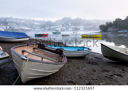 The tide is on its way in on a misty morning in Devon.  Taken in Noss Mayo looking towards Newton Ferrers.