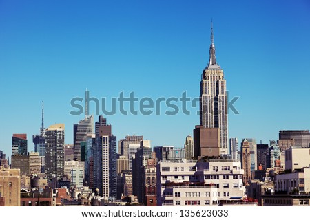 The tight cluster of skyscrapers habituating midtown Manhattan with the famous Empire State Building most prominent, as seen viewing north from the West Village.