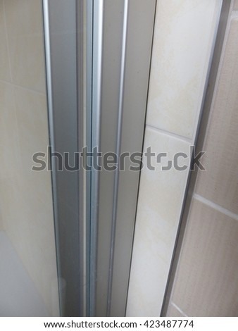 The tiling over tiles in the bathroom saves time and money - stock photo