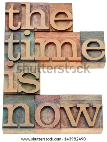 the time is now - motivational concept - isolated text in letterpress wood type - stock photo