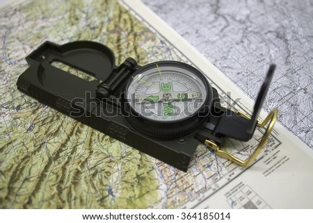 the time-tested Navigator/ assistant on travel/modern compass on the map - stock photo