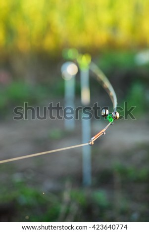 The tip of the rod with the bell. - stock photo
