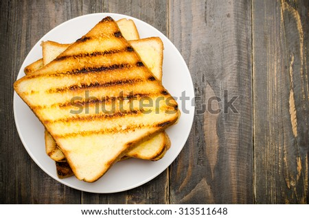 The toast on wooden background,breakfast or meal - stock photo