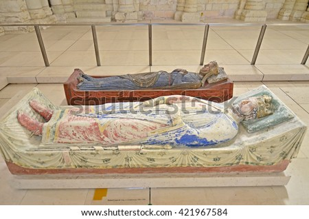 The tomb of King Richard the Lionheart of England in Fontevraud Abbey next to Queen Isabella of England - stock photo