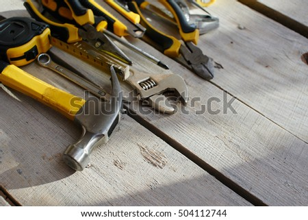 The tool kit is on the table from the wooden planks