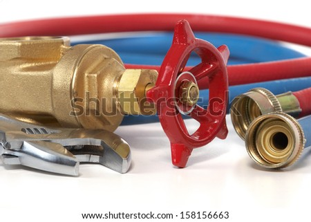 The tool of the plumber on a white background