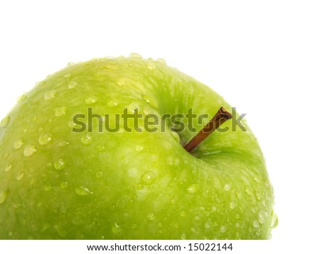 The top of a standing single fresh ripe green apple with water drops and isolated on white background - stock photo