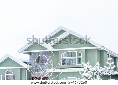 The Top Of A Typical American Home In Winter Snow Covered Roof And Nice Window