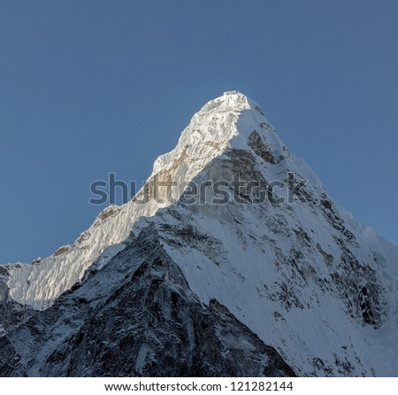 The top of Ama Dablam (6814 m) from North - Nepal, Himalayas - stock photo