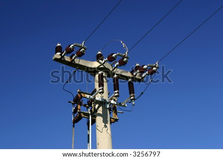 The Top of an old power pole in deep blue sky.