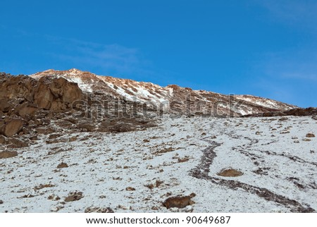 The top of the cone of Kilimanjaro (5.895 m) in the morning light - Tanzania - stock photo
