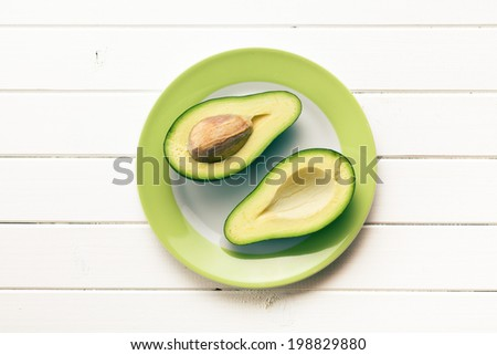 the top view of halved avocados - stock photo