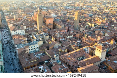 The top view of the red roofs and the car free boulevard of the old Bologna city, Emilia-Romana Region, Italy. February 26, 2016