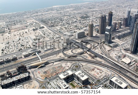 The top view on Dubai from the highest tower in the world, Burj Khalifa (828 metres). United Arab Emirates. - stock photo