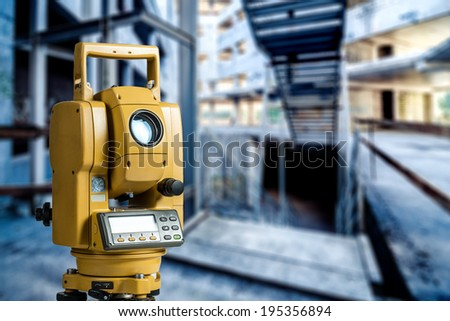 The total station surveying, measuring tool in interior  - stock photo