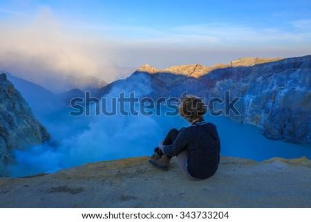 The Tourist relaxing at Kawah Ijen Volcano, East Java island, Indonesia - stock photo