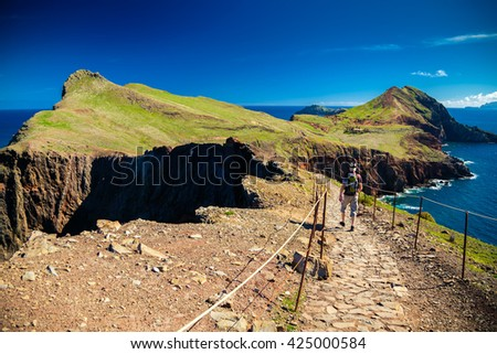 the tourist walking on a trekking path at Ponta de Sao Lourenco, Madeira