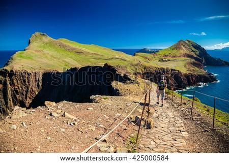 the tourist walking on a trekking path at Ponta de Sao Lourenco, Madeira - stock photo