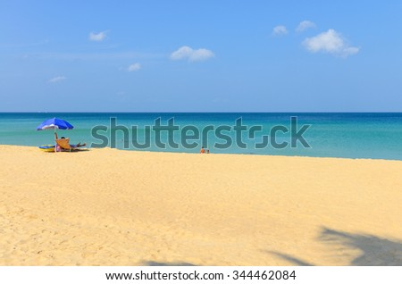 The tourists are Relaxing on Karon beach in Phuket, Thailand
