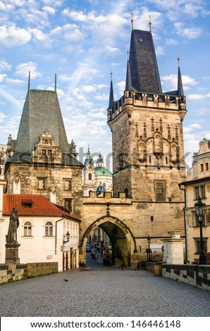 The Tower at the end of the Charles Bridge and Judith Tower, (one of the symbols of Prague) - stock photo